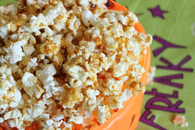 Caramel Candy Popcorn: Microwave popcorn topped with an easy to make candy coated caramel topping!