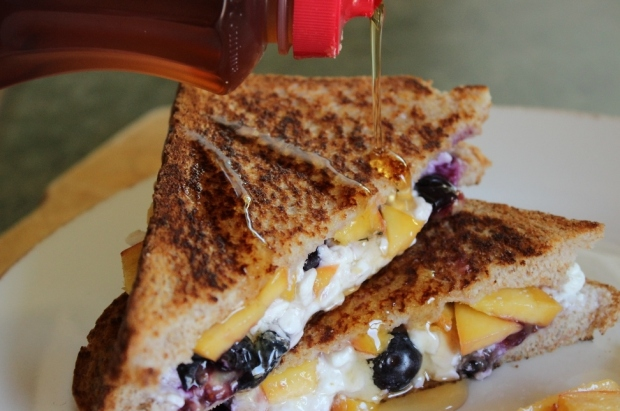 This Grilled Breakfast Sandwich is extra good drizzled with sweet syrup!