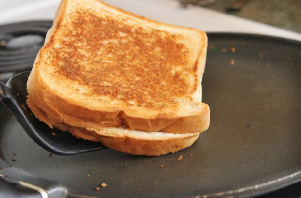 A Golden Brown Grilled Ham and Gouda Sandwich can be made in a few simple steps!