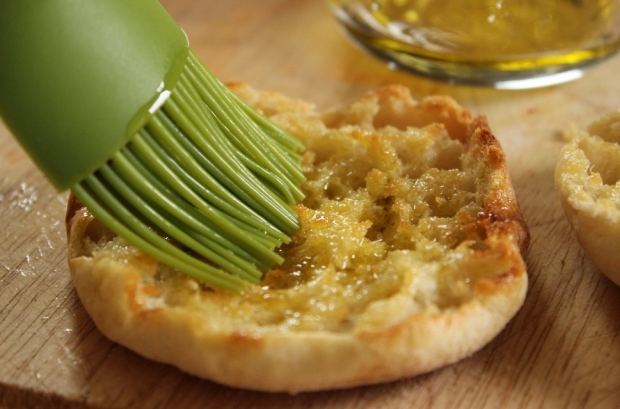 To keep your English muffin mini pizza from getting soggy