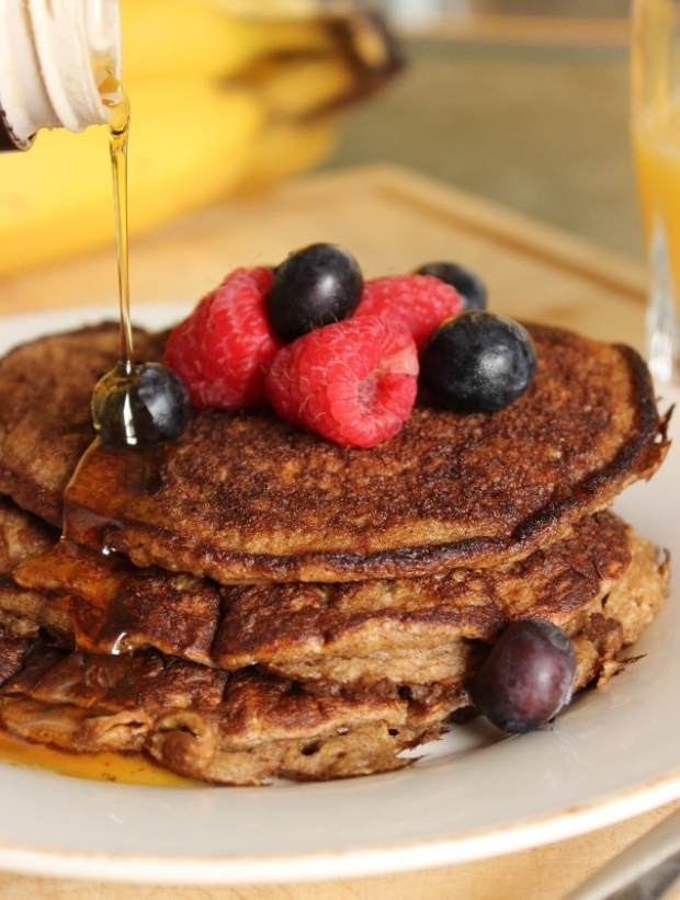 These Oatmeal-Banana Pancakes are nutritious and delicious drizzled with pure maple syrup.