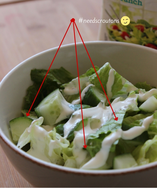 Chopped romaine lettuce salad with diced cucumbers and Ranch dressing